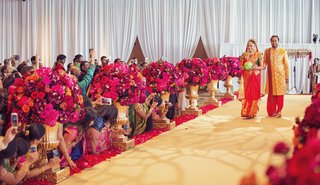 indian-wedding-bride-and-brother-in-traditional-indian-wedding-attire-walk-down-aisle