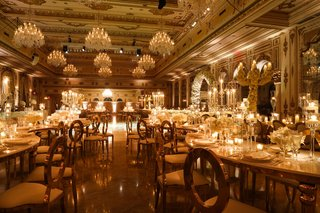 wedding-reception-the-mar-a-lago-club-opulent-luxury-ballroom-chandelier-serpentine-table-oval-back