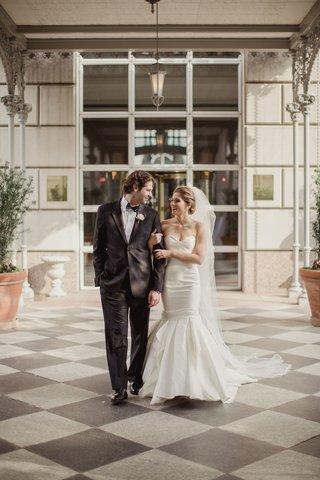 bride-in-strapless-mermaid-wedding-dress-sweetheart-neckline-groom-in-suit-and-bow-tie-checker-floor