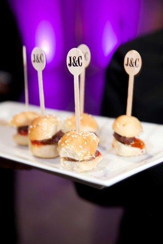 miniature-hamburger-slider-with-sesame-seed-bun-and-custom-tooth-picks