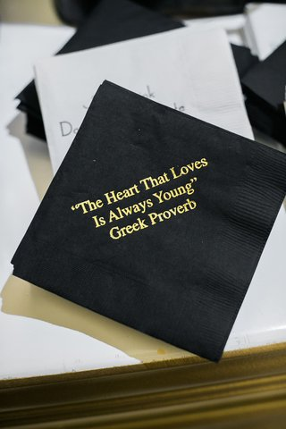 black-cocktail-napkin-with-gold-printed-greek-proverb