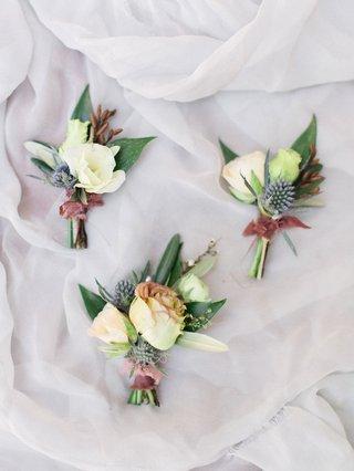 wedding-boutonniere-blue-thistle-white-flower-dusty-rose-ribbon-greenery-organic-flower-ideas