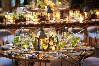 lantern-centerpiece-at-rustic-wedding-with-striped-napkins
