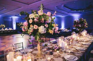 large-floral-centerpieces-with-candles-blue-violet-uplighting