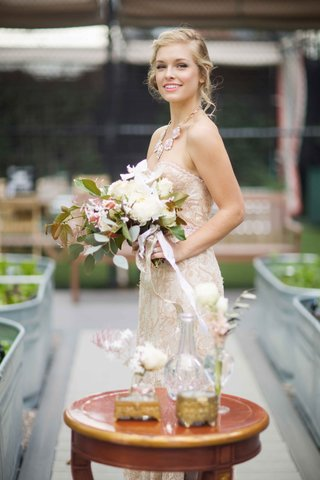 bride-in-champagne-gown-pink-lipstick-bouquet-with-lots-of-foliage