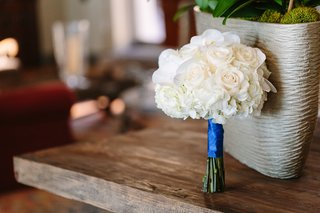 white-rose-nosegay-bridesmaid-bouquet-tied-with-royal-blue-ribbon