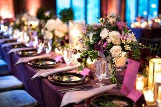 wedding-reception-table-purple-linen-low-centerpiece-pink-purple-white-greenery-details-barn
