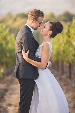 groom-in-black-grey-suit-and-glasses-with-bride-in-mira-zwillinger-wedding-dress-carines-bridal