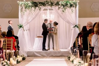interfaith-ceremony-with-south-asian-bride-ceremony-structure-with-white-drapery-and-greenery
