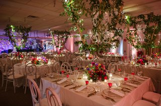 wedding-reception-ballroom-large-lanterns-gold-square-round-tables-pink-flowers-roses-greenery