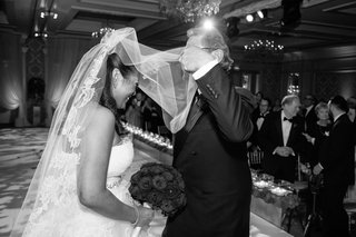 black-and-white-photo-of-father-of-the-bride-lifting-vera-wang-blusher-veil-of-bride