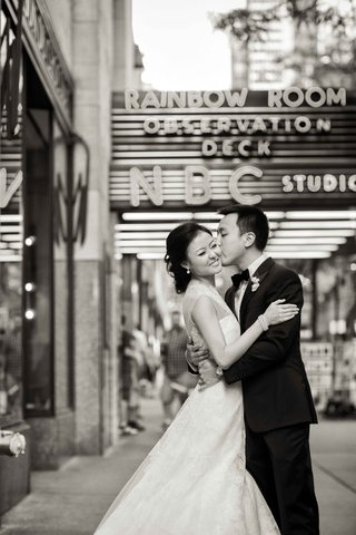 black-and-white-photo-of-chinese-american-bride-and-groom-in-front-of-rainbow-room-wedding-venue-nyc