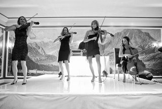 black-and-white-photo-of-women-playing-instruments