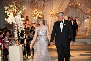 mother-of-groom-in-illusion-dress-with-metallic-bodice-and-father-in-tuxedo-and-bow-tie