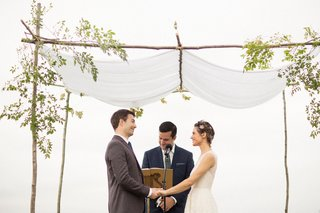 wedding-ceremony-under-chuppah-hand-made-by-groom-best-friend-officiant-vineyard-wedding