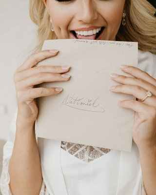 former-miss-america-savvy-shields-licking-envelope-for-love-letter-to-groom-on-wedding-day