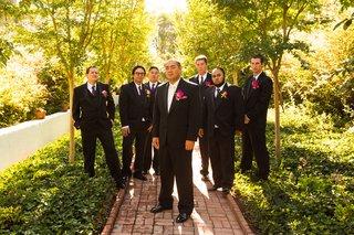 long-beach-wedding-groomsmen-in-black-suits