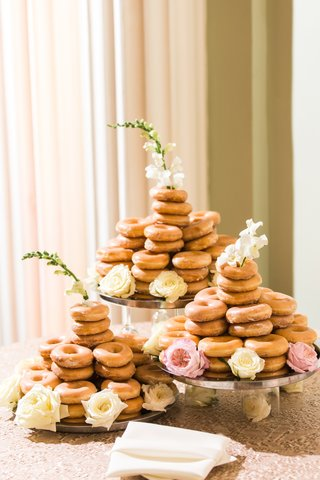 krispy-kreme-tower-of-glazed-doughnuts-on-stands-in-cake-form-flowers-at-base-and-top