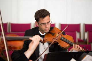 man-playing-violin-at-church-wedding-ceremony