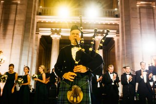 wedding-reception-scottish-tradition-bagpiper-introducing-bride-and-groom-at-reception-newlyweds
