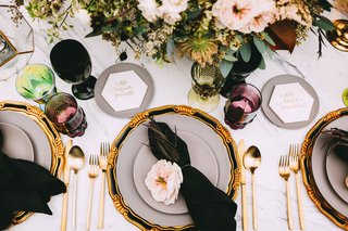 wedding-reception-top-view-black-napkin-pink-flower-gold-flatware-hexagon-marble-name-plate-colors