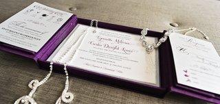 brides-rhinestone-headdress-and-necklace-on-purple-gatefold-wedding-invitation-box