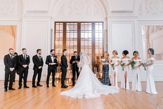 wedding-ceremony-with-bridesmaids-and-groomsmen-historic-ballroom-los-angeles-downtown-la-candles