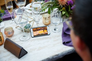 wedding-guest-watches-nba-game-7-finals-on-phone-during-reception