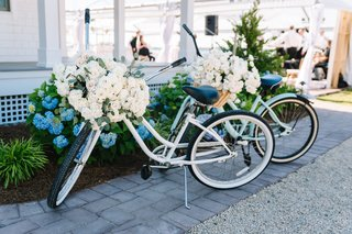 two-beach-cruiser-bikes-adorned-with-flowers-for-at-home-wedding-decor