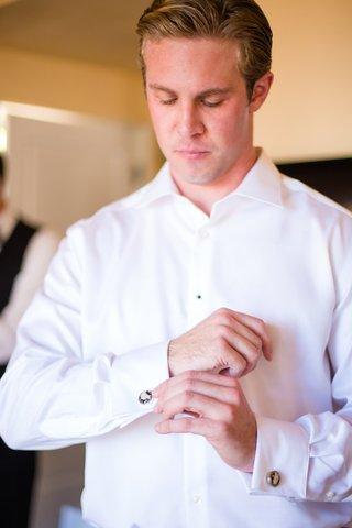 groom-fixing-cufflinks-wedding-la-jolla-san-diego-california-white-shirt-formal-beachy-la-valencia