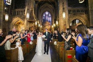 bride-and-groom-walk-up-church-wedding-aisle