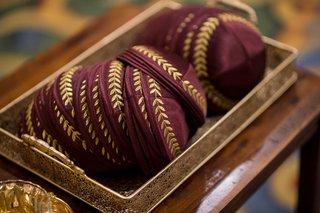 marsala-colored-yarmulkes-kippahs-wine-details-gold-jewish-wedding-tradition-florida