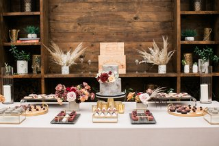 plentiful-dessert-table-at-bridal-shower-with-small-two-tier-grey-cake