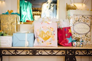 wedding-shower-gift-bags-from-guests-on-console-table-beverly-hills-ballroom