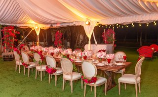 wedding-reception-wood-table-chairs-pink-red-rose-garlands-low-centerpiece-red-glassware