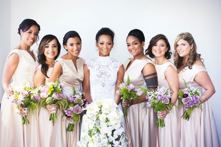 bride-in-high-neck-lace-wedding-dress-bridesmaids-in-champagne-pink-v-neck-bateau-dresses-purple