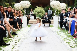 adorable-flower-girl-with-babys-breath-flower-crown-and-large-white-tulle-skirt