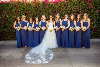 bride-in-strapless-monique-lhuillier-wedding-dress-bridesmaids-in-royal-blue-navy-gowns-necklines