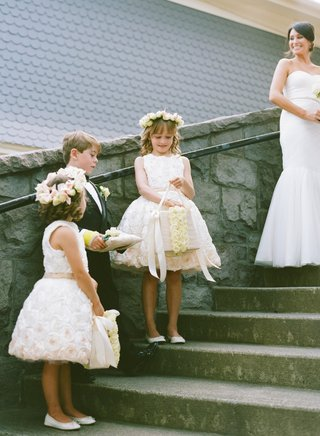 flower-girls-with-rose-dresses-and-flower-crowns-on-stairs
