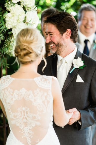 bride-in-a-claire-pettibone-gown-with-illusion-back-with-ceo-ted-adams-in-grey-suit-white-tie
