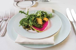 wedding-reception-salad-course-with-frisee-arugula-watermelon-radish-on-monique-lhuillier-china