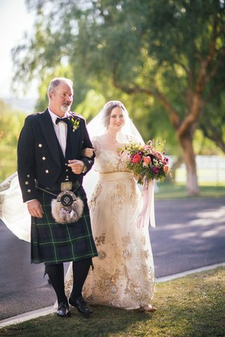 bride-in-a-claire-pettibone-dress-with-gold-and-silver-embroidery-veil-and-father-in-a-blue-kilt