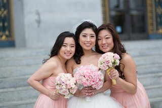 bride-with-two-bridesmaids-in-strapless-pink-j-crew-bridesmaid-dresses