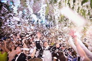 wedding-reception-dance-floor-confetti-guests-live-band-flower-ceiling-installation