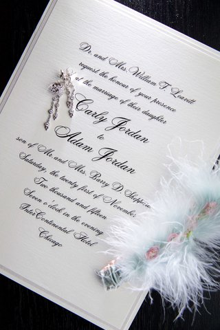 classic-wedding-invitation-white-with-black-script-calligraphy-feather-garter-blue-and-earrings