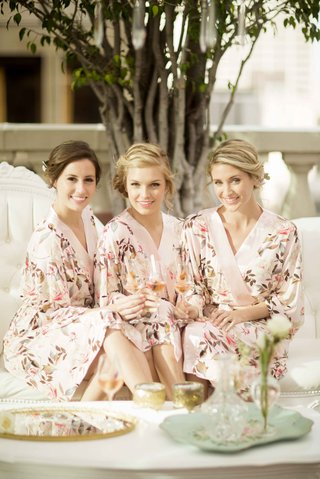 brides-and-bridesmaids-in-floral-robes-drinking-champagne
