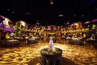 wedding-reception-twinkle-lights-purple-lighting-tall-cake-round-table-gobo-light-projection