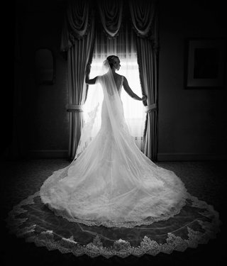 black-and-white-photo-of-bride-in-matthew-christopher-and-nymphi-cathedral-veil-lace