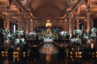 indoor-wedding-ceremony-at-vibiana-white-flowers-and-greenery-at-ceremony