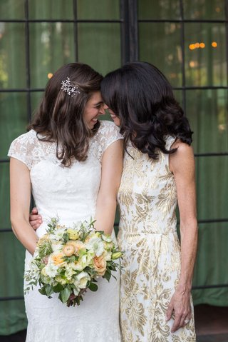 bride-in-white-lace-cap-sleeve-gown-from-mark-ingram-atelier-with-mom-smiling-and-laughing-wedding